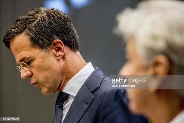 Dutch Prime Minister Mark Rutte and Minister Ronald Plasterk of the Ministry of the Interior address the media during a news conference about the...