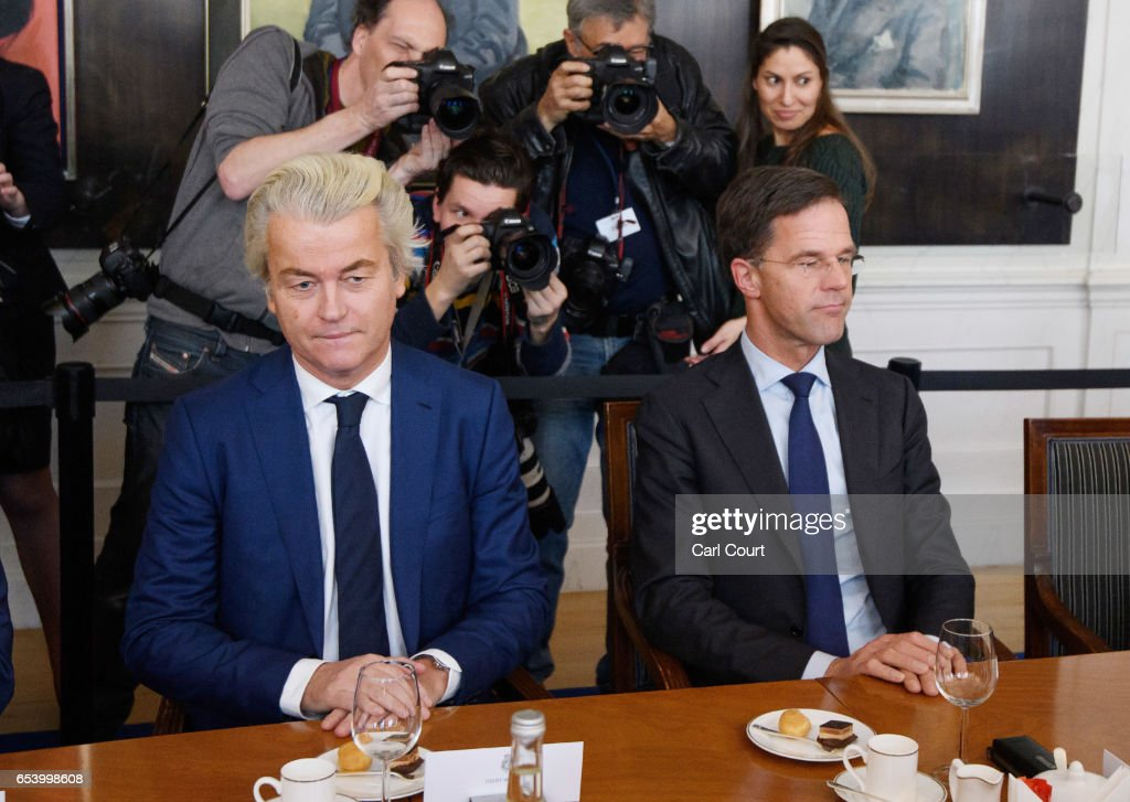 Dutch Prime Minister Mark Rutte (R) and Party for Freedom (PVV) leader Geert Wilders sit next to each other during a meeting of Dutch political party leaders at the House of Representatives to express their views on the formation of the cabinet, on March 16, 2017 in The Hague, Netherlands. Prime Minister Mark Rutte was reelected for a second term in yesterday's general election which also saw the right-wing Party for Freedom (PVV) led by Geert Wilders become the country's second largest party.