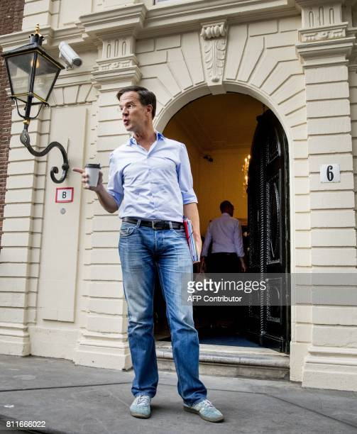 Dutch Prime Minister Mark Rutte arrives at the Johan de Witthuis in The Hague on June 14 2017 / AFP PHOTO / ANP / Jerry Lampen / Netherlands OUT