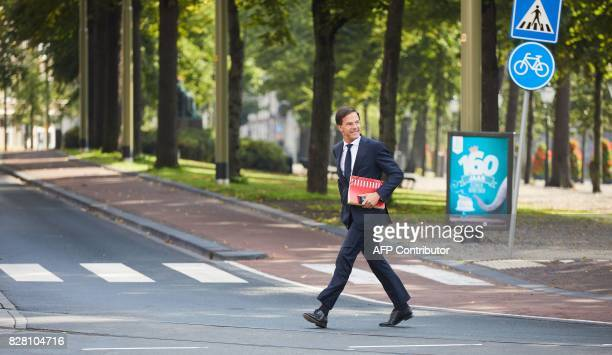 Dutch Prime Minister Mark Rutte arrives at the Johan de Witthuis in The Hague on August 9 as talks on a new cabinet formation resume after a...