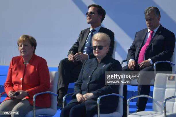 Dutch Prime Minister Mark Rutte flanked by Hungary's Prime Minister Viktor Orban German Chancellor Angela Merkel and Lituania's President Dalia...