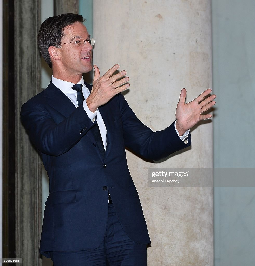 Dutch Prime Minister Mark Rutte gestures after being welcomed by French President Francois Hollande (not seen) at the Elysee Palace in Paris, France on February 12, 2016.