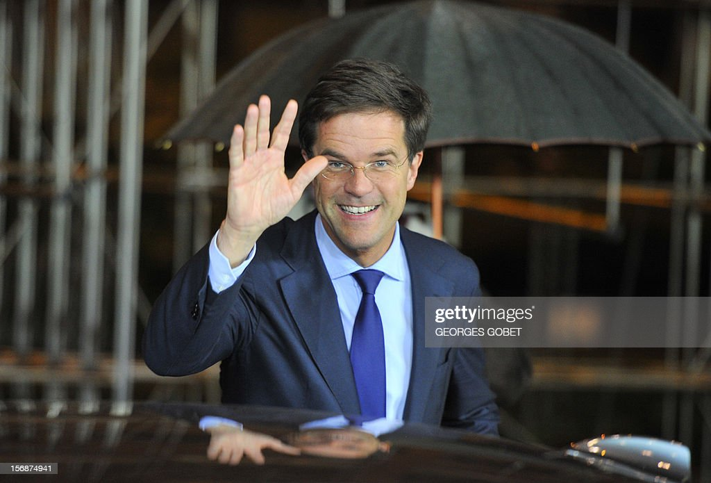 Dutch Prime Minister Mark Rutte gestures as he leaves the EU Headquarters, on November 23, 2012 in Brussels, after a two-day European Union leaders summit called to agree a hotly-contested trillion-euro budget through 2020. EU Council President Herman Van Rompuy said today that an EU budget deal was within reach early next year, after a two-day summit collapsed without agreement.