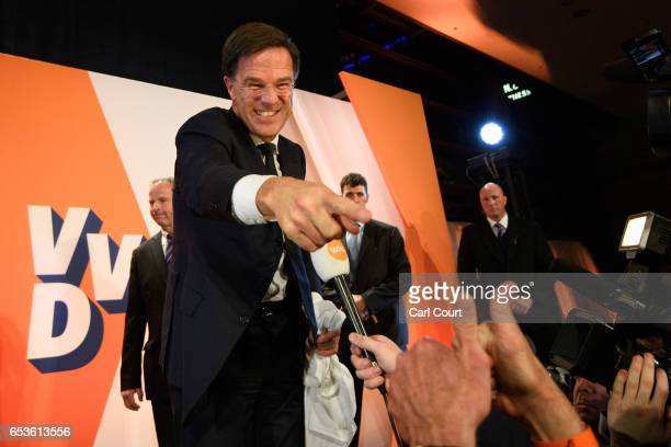 Dutch Prime Minister Mark Rutte gestures to a supporter after making a speech following his victory in the Dutch general election on March 15 2017 in...