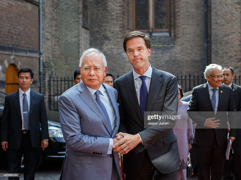 Dutch Prime minister Mark Rutte holds hands with Malaysian Prime Minister Najib Razak upon his arrival on July 31 2014 in The Hague Netherlands Razak...