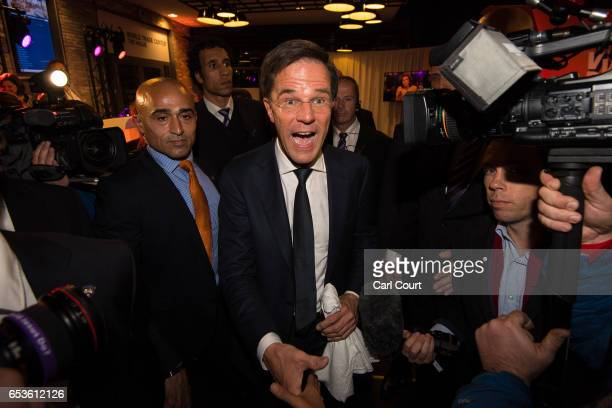 Dutch Prime Minister Mark Rutte is greeted by supporters as he leaves after making a speech following his victory in the Dutch general election on...