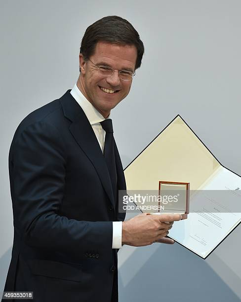 Dutch prime minister Mark Rutte poses with the 'Walter Rathenau' prize recognizing his commitment towards foreign and European policy after being...