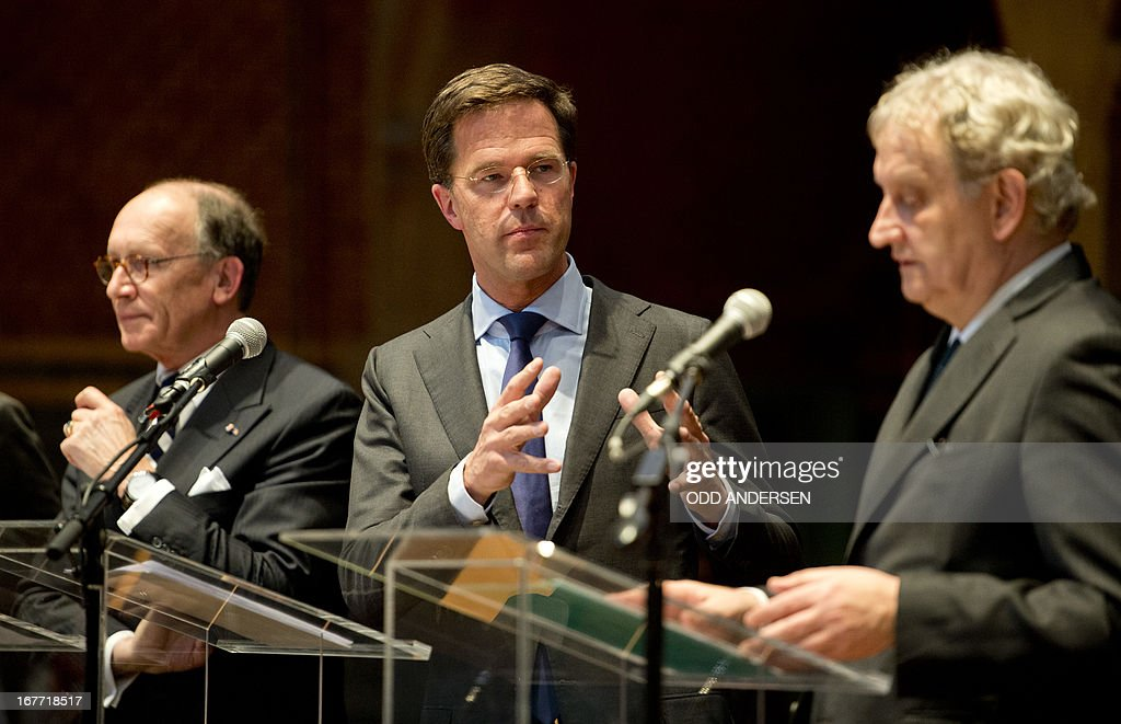 Dutch Prime minister Mark Rutte (C) speaks during a joint press conference on the upcoming Royal investiture, with Mayor of Amsterdam Eberhard van der Laan (R) and President of the Ddutch Senate Fred de Graaf (L) in Amsterdam on April 28, 2013. Queen Beatrix of the Netherlands announced her abdication on January 28, 2013. After 33 years on the throne, the Queen will relinquish the crown at the end of April, leaving the monarchy to Crown-Prince Willem-Alexander, the oldest of her three sons. AFP PHOTO / ODD ANDERSEN