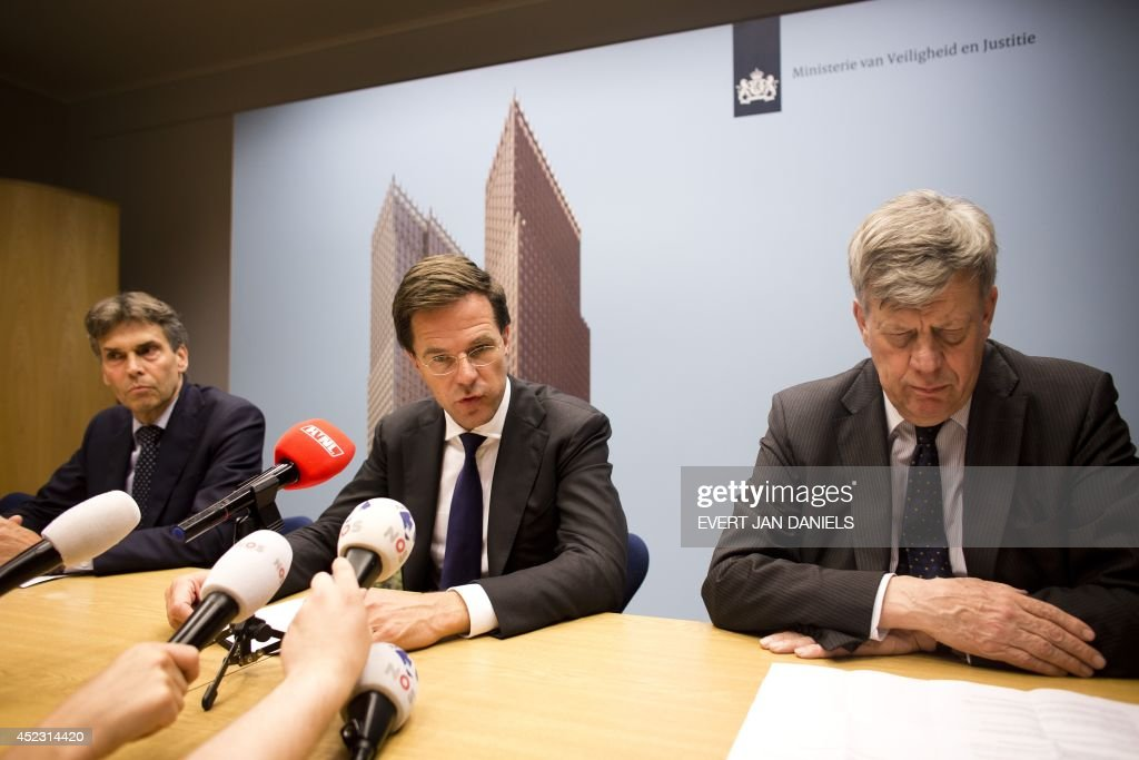 Dutch Prime Minister Mark Rutte speaks next to counterterrorism unit coordinator Dick Schoof and Minister of Security and Justice Ivo Opstelten...