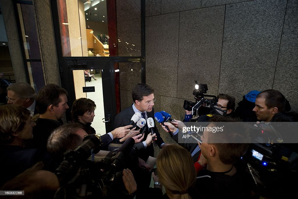 Dutch Prime Minister Mark Rutte speaks with the press after the weekly debate with the cabinet in the Senate, The Hague, The Netherlands, on January 29, 2013. The Senate issued the announcement of Queen Beatrix that she will abdicate on April 30. AFP _PHOTO/ PHIL NIJHUIS netherlands out