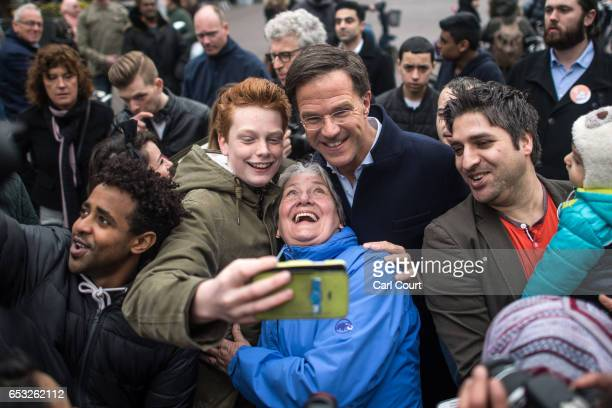 Dutch Prime Minister Mark Rutte takes a selfie photograph with supporters as he campaigns ahead of tomorrow's general election on March 14 2017 in...