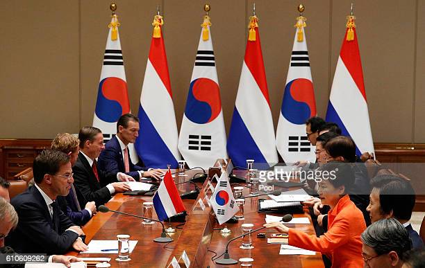 Dutch Prime Minister Mark Rutte talks with South Korea's President Park GeunHye during their meeting at the Presidential blue house on September 27...