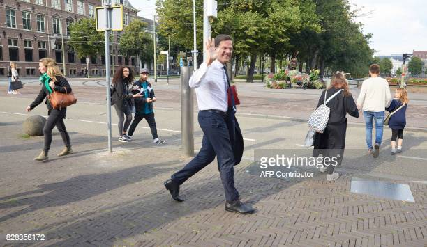 Dutch Prime Minister Mark Rutte waves to photographers as he leaves after government formation talks at the Johan de Witthuis in The Hague The...