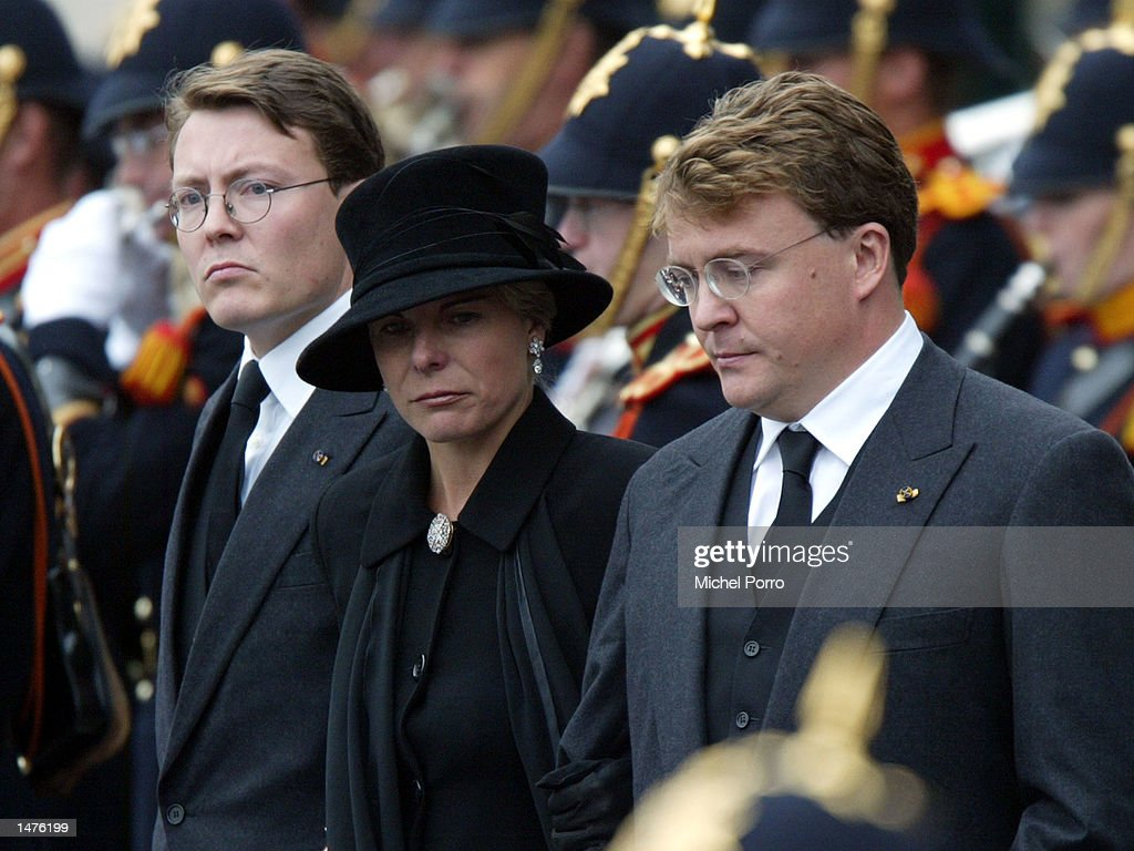 Dutch Prince Constantijn, Princess Laurentien and Prince Johan Friso leave the Nieuwe Kerk church after the funeral ceremony for Prince Claus October 15, 2002 in Delft, Netherlands. Prince Claus, husband to Queen Beatrix, died October 6, 2002 after a long battle with Parkinson's disease and pneumonia.