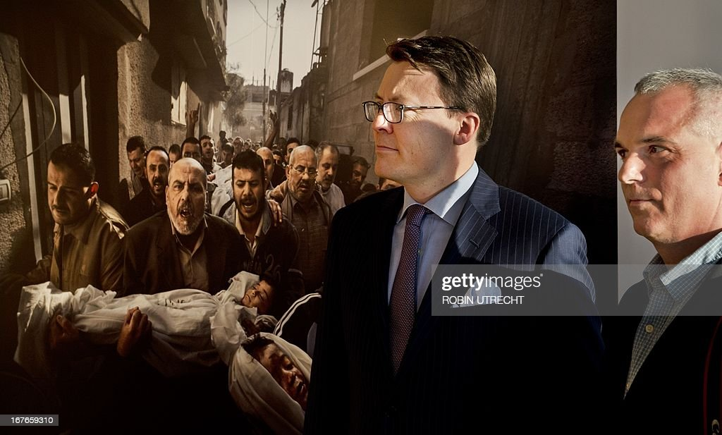 Dutch Prince Constantijn (L) stands with Swedish photographer and World Press Photo of the Year winner Paul Hansen in front of his winning picture during the World Press Photo Award of 2012 in Amsterdam, The Netherlands on April 27, 2013. The image shows the bodies of two Palestinian children who were killed in an Israeli missile strike being carried to their funeral.