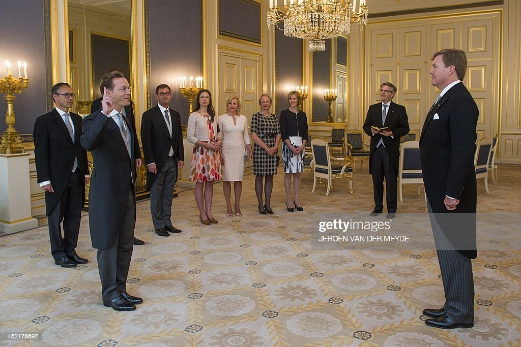 Dutch Prince Jaime de Bourbon de Parme (2nd L), son of Princess Irene, is sworn in on July 15, 2014 by Dutch King Willem-Alexander (R) as Dutch ambassador to the Vatican at Noordeinde palace in The Hague. The prince previously worked in Iraq and Afghanistan and was special representative for raw materials at the Dutch Foreign Ministry. AFP PHOTO / POOL / JEROEN VAN DER MEYDE - netherlands out -