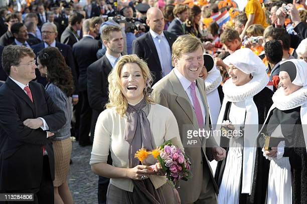 Dutch Prince Willem Alexander his wife Princess Maxima and his brother Constantijn take part in the Queen's day celebration in Thorn on April 30 2011...