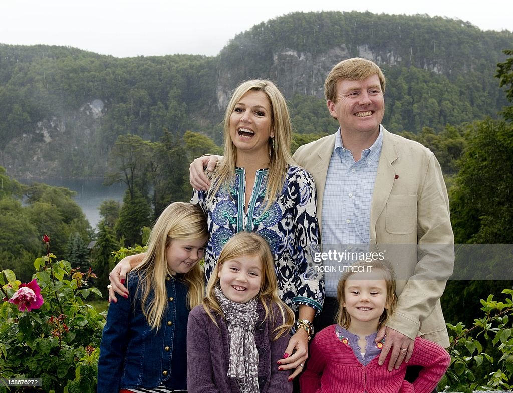 Dutch Prince Willem-Alexander and Princess Maxima pose for a photograph with their children (From L to R) Princess Amalia, Princess Alexia and Princess Ariane, during a photo shoot at El Messidor, the residence of the governor of the province of Neuquen, in Villa la Angustura, Argentina, on December 23, 2012. The royal couple is spending the Christmas holidays with friends and family in Argentina. AFP PHOTO / ANP / ROBIN UTRECHT