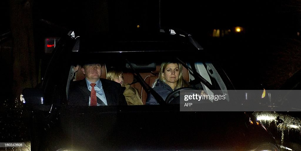 Dutch Prince Willem-Alexander arrives together with Princess Maxima at the wheel at Palace Eikenhorst on January 28, 2013. Queen Beatrix of the Netherlands announced on January 28, 2013 that she would abdicate in favour of her son Crown Prince Willem Alexander at the end of April after 33 years in power. AFP PHOTO / ANP ROYAL IMAGES / FRANK VAN BEEK netherlands out
