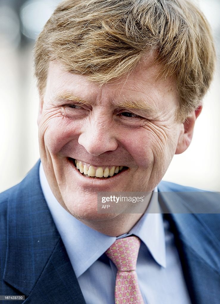 Dutch prince Willem-Alexander poses during the opening of The Next Web Conference in Amsterdam on April 25, 2013. At this international conference specialists and entrepreneurs from around the world discuss the future of technology, internet and media. AFP PHOTO / ANP - ROYAL IMAGES KOEN VAN WEEL - netherlands out