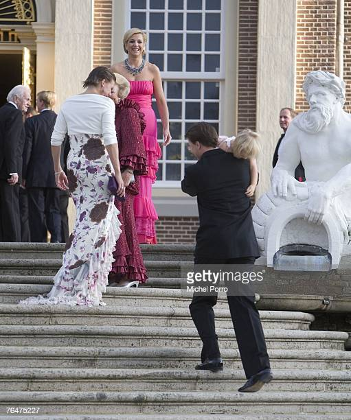 Dutch Princess Alexia is lifted up the stairs by Dutch Prince Constantijn while LR Princess Laurentien Queen Beatrix and Princess Maxima laugh after...