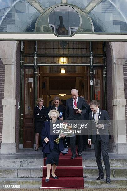 Dutch Princess Beatrix leaves the cityhall of Baarn on February 4 after officially registering herself as a resident of the municipality She will...