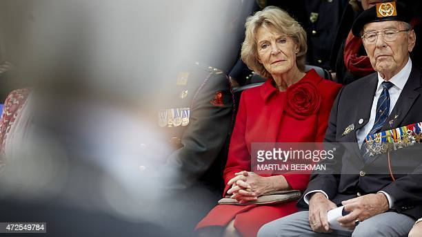 Dutch Princess Irene and war veterans are pictured during the parade of Guards Regiment Fusiliers in The Hague on May 8 2015 The parade is to...