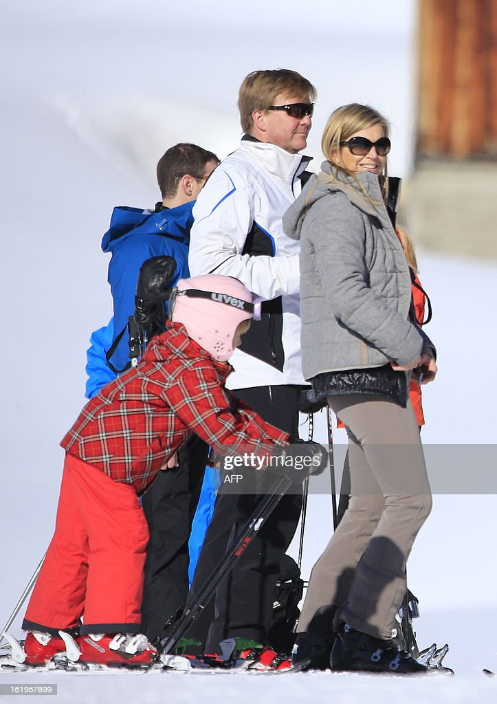 Dutch Princess Maxima (R) and Dutch crown Prince Willem-Alexander (L) look on as Princess Ariane (L) skis during a photocall session as part of the Dutch Royal Family's during their ski holidays in Lech am Arlberg, western Austria, on February 18, 2013.