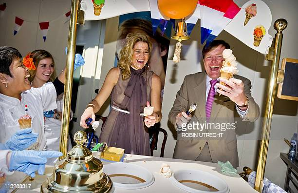 Dutch Princess Maxima and Prince WillemAlexander scoop ice cream during the Queensday celebration in Weert on April 30 2011 AFP PHOTO/ANP/POOL/ROYAL...