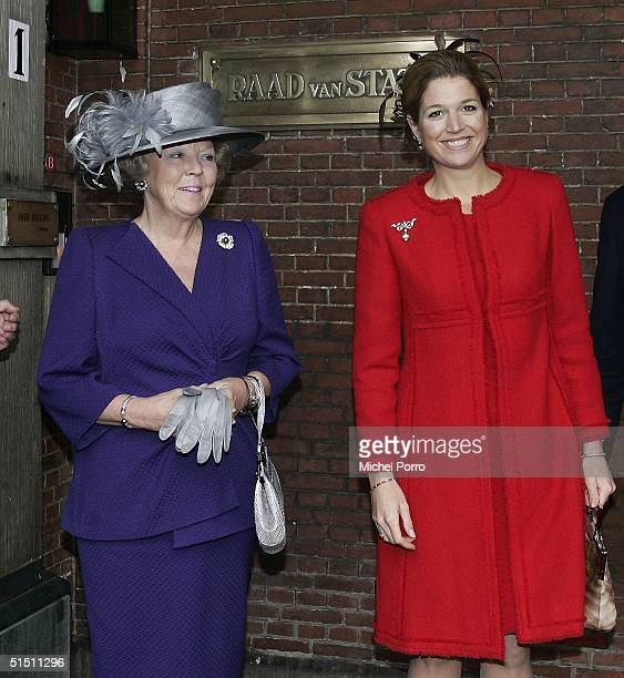 Dutch Princess Maxima stands next to Queen Beatrix before Maxima would take seat for the first time in the 'Raad van State' the advisory body to the...
