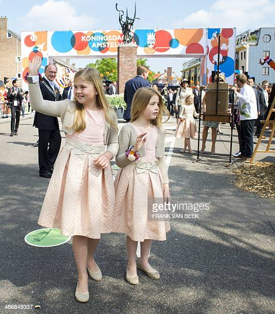 Dutch Princesses Amalia and Alexia wave to the crowd in Amstelveen The Netherlands on April 26 during the first King's Day the celebration of the...