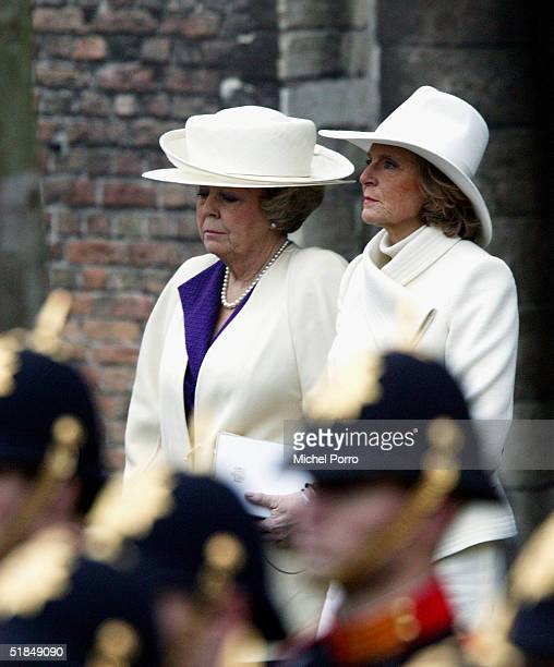 Dutch Queen Beatrix and her sister Princess Irene exit the church after the funeral of their father Prince Bernhard on December 11 2004 in Delft The...
