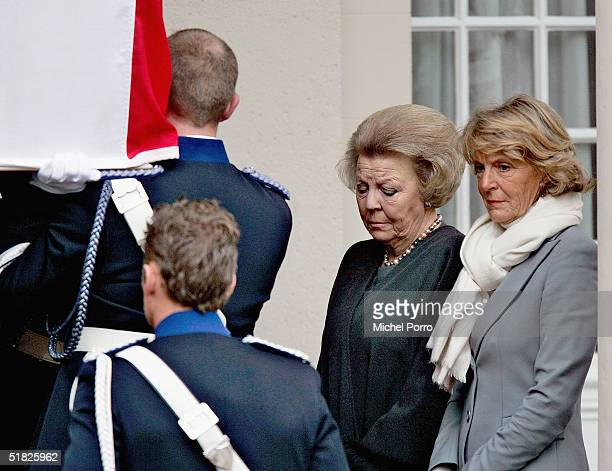 Dutch Queen Beatrix and Princess Irene watch the coffin of their father Prince Bernhard at the Noordeinde Palace on December 5 2004 in The Hague The...