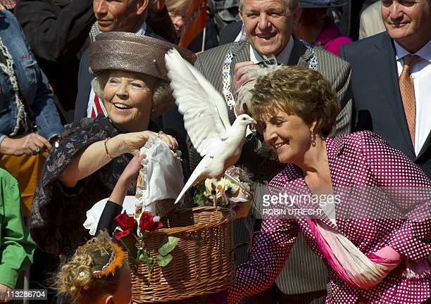 Dutch Queen Beatrix and Princess Margriet release pigeons during the Queen's Day celebration in Weert on April 30 2011 Queen's Day is a national...