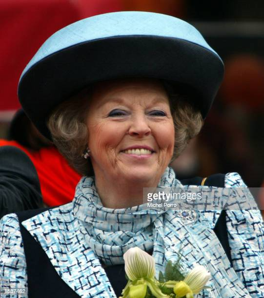 Dutch Queen Beatrix attends 'Queen's Day' the nation's biggest holiday April 30 2002 in Meppel The Netherlands Traditionally Queen Beatrix celebrates...