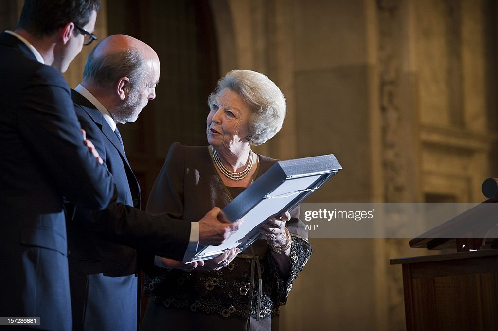 Dutch Queen Beatrix awards the Belgium poet Leonard Nolens with the Prize of Dutch Literature in the Royal Palace on the Dam in Amsterdam, The Netherlands, on November 30, 2012. Every three years, the Committee of Ministers of the Dutch Language Union hands out the Prize of Dutch Literature. This award distinguishes major authors with originally written Dutch literary works.AFP PHOTO/ FRANK VAN BEEK netherlands out
