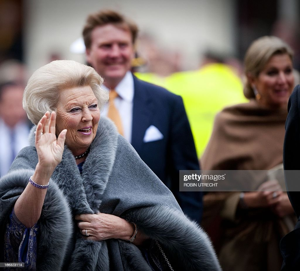 Dutch Queen Beatrix gestures as she attends the celebration for the tricentenary of the Treaty of Utrecht in the Dom Church (Domkerk), in Utrecht, The Netherlands, on April 11, 2013.