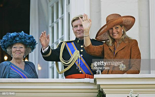Dutch Queen Beatrix her son Crown Prince WillemAlexander and his wife Princess Maxima wave to the crowd after the Parliamentary Budget Presentation...