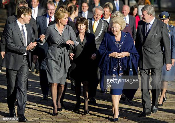 Dutch Queen Beatrix listens to explanations from British actress and Human Rights activist Emma Thompson during their visit of the Journey...