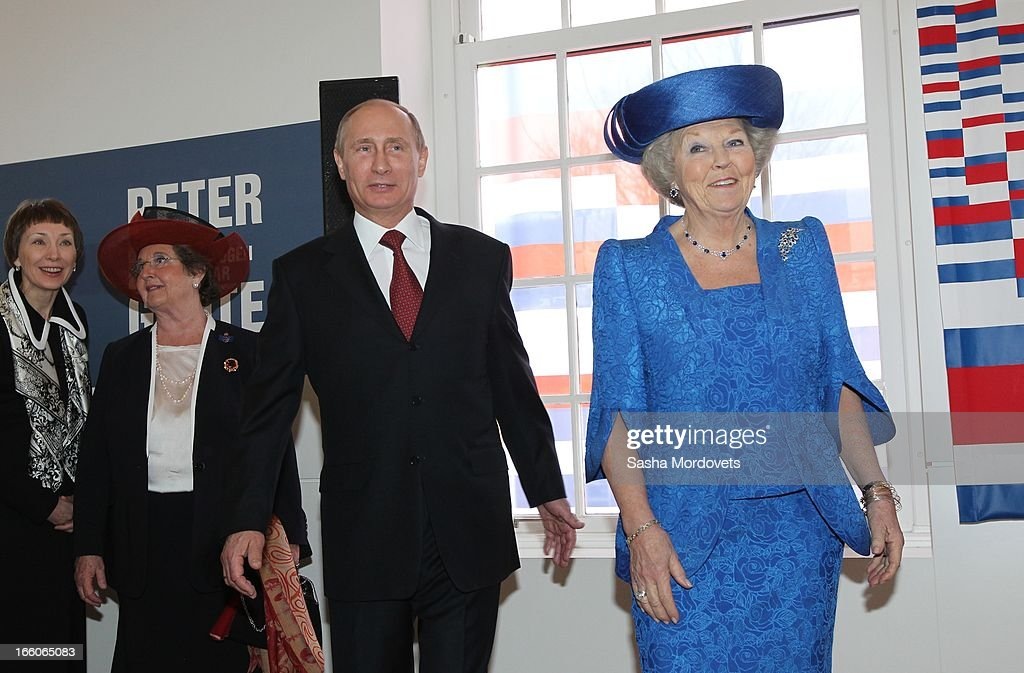Dutch Queen <a gi-track='captionPersonalityLinkClicked' href=/galleries/search?phrase=Beatrix+of+the+Netherlands&family=editorial&specificpeople=92396 ng-click='$event.stopPropagation()'>Beatrix of the Netherlands</a> (L) meets Russian President <a gi-track='captionPersonalityLinkClicked' href=/galleries/search?phrase=Vladimir+Putin&family=editorial&specificpeople=154896 ng-click='$event.stopPropagation()'>Vladimir Putin</a> (R) as they unveil a plaque during their visit at the Hermitage Museum April 8, 2012 in Amsterdam, Netherlands. Putin began a one-day state visit to the Netherlands at the invitation of Queen Beatrix.