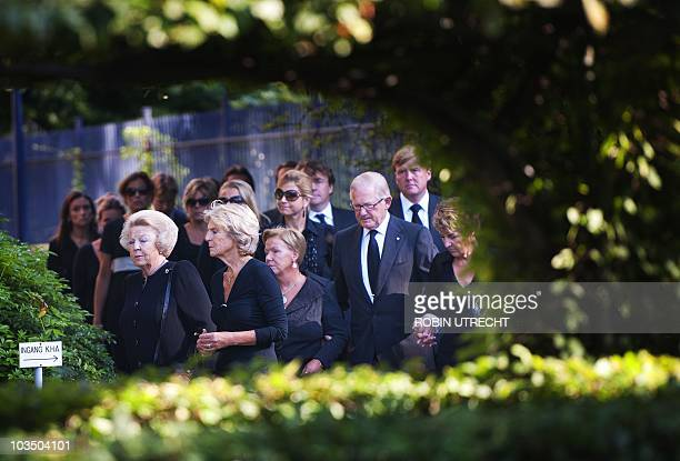 Dutch Queen Beatrix Princess Irene and other royal family members walk towards Noordeinde Palace in The Hague the Netherlands on August 20 to pay...