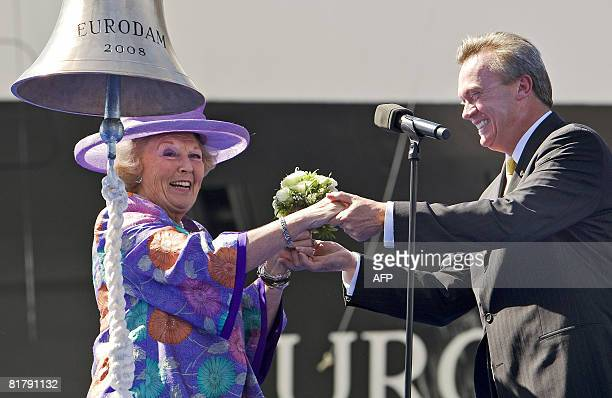 Dutch Queen Beatrix receives flowers from Holland America Line CEO Stein Kruse during christening ceremony of the MS Eurodam ship the 14th cruiseship...