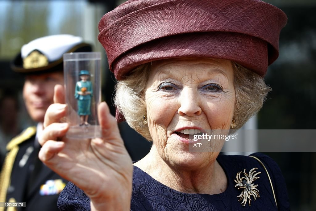 Dutch Queen Beatrix shows a miniature of herself during the opening of the renovated Madurodam in The Hague, The Netherlands on April 21, 2012. AFP PHOTO/ANP ROYAL IMAGES BAS CZERWINSKI netherlands out -