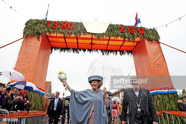 Dutch Queen Beatrix waves to the crowd during the Queen's Day festivities in Wemeldinge on April 30 2010 The Netherlands' Queen Beatrix celebrates 30...