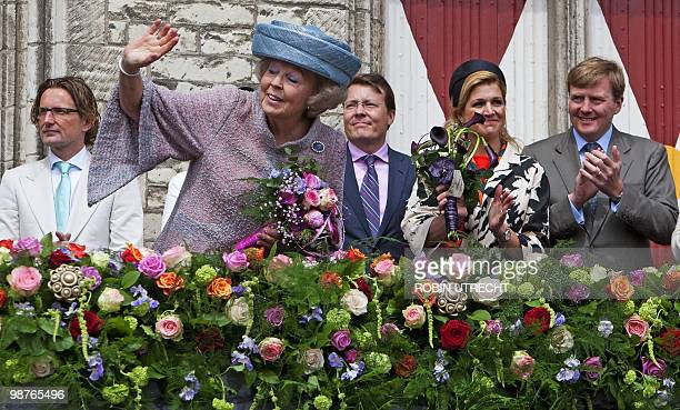 Dutch queen Beatrix with Prince Bernhard Jr Prince Constantijn Princess Maxima and Prince Willem Alexander in the background from Left greats the...