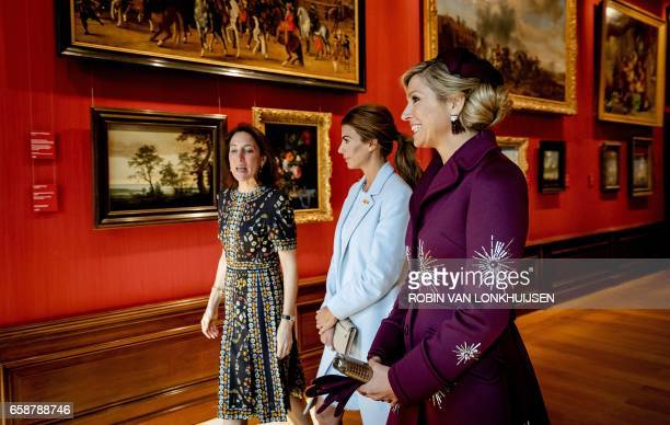 Dutch Queen Maxima and Argentine First Lady Juliana Awada listen to the explanations of museum director Emilie ES Gordenker during their visit at the...