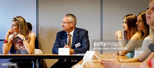 Dutch Queen Maxima and CEO of the Dutch Association of Insurers Richard Weurding attend a money school lesson during a visit to a school in Amsterdam...