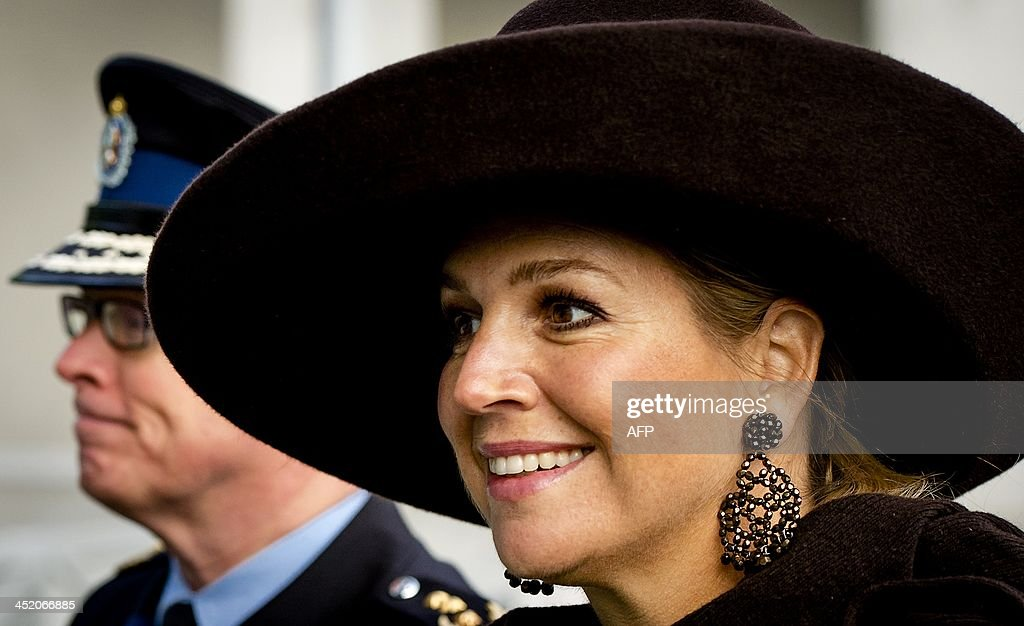 Dutch Queen Maxima (R) and the commander of the Royal Military Police, Hans Leijtens, arrive on November 26, 2013 for the opening of the Koningin Maximakazerne (Queen Maxima station) of the Dutch Royal Military Police in Schiphol. LONKHUIJSEN - netherlands out -