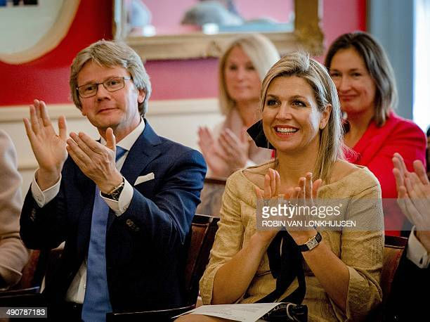 Dutch Queen Maxima applauds next to the head of the 'Music in the House' foundation Martin de Gier while attending a piano concert in honor of the...