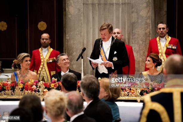 Dutch Queen Maxima Argentinian First Lady Juliana Awada President Mauricio Macri listen as Dutch King WillemAlexander delivers a speech during a...